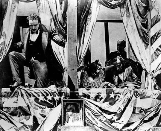 John Wilkes Booth (Raoul Walsh) flees after shooting Abraham Lincoln in D.W. Griffith's Birth Of A Nation